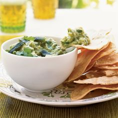 In this lightened version of guacamole, tomatillo puree replaces some of the rich avocado, adding a bit of sweetness and tang; roasted poblano contrib...