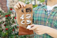 Cordito is a stylish handcrafted leather cord carrier. When unrolled, the case has three slots to tuck in your cables and headphones, plus a pocket for extras like phone lenses, USB drives, and other technology accessories. Once filled roll it up and secure it neatly closed with the adjustable straps.