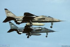 Pair of French Armée de l'Air Sepecat Jaguars, showing the camouflage of Iraq and central Europe, on finals, 1994.