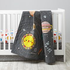 Deep Space Crib Bedding  | The Land of Nod I love this new crib set with happy planets and a happy sun. Would be awesome in an outer space nursery.