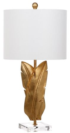 Adorned in an opulent gold finish and paired with an off- white shade, this traditional table lamp (set of 2) recalls modern sculptures exhibited at London