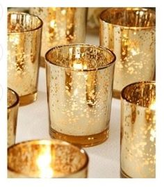 Gold Mercury glass votives would be pretty.
