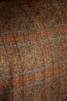 Glen Royal fabric from Porter & Harding with a herringbone ground and over-check.