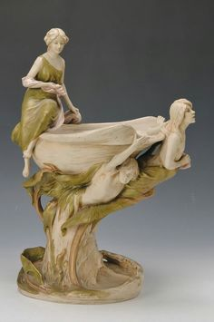 Large art nouveau centerpiece, Eduard Eichler Dux, around1910, porcelain, with three fully plastic figurines, opulent embossed with plants, gold decoration, H. approx. 49cm.