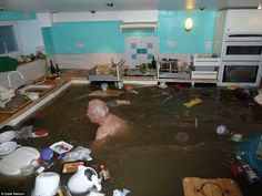 One defiant homeowner in Kendal, Cumbria, decided to pop his swimming trunks on and go for...