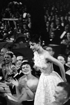 Audrey Hepburn goes to receive her Best Actress Oscar for Roman Holiday at the 1954 Academy Awards presentation ceremony at the NBC Century Theatre in New York. (There were simultaneous presentations in New York and Hollywood that year. Hepburn was.