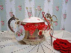 Made from a sweet little sugar pot who lost her lid and a bit of vintage hanky---how's that for some cute upcycling?!