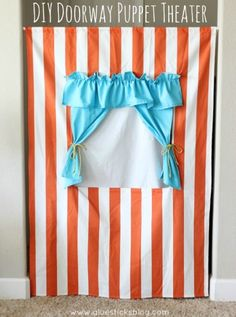 DIY Doorway Puppet Theater: easy to make and would be great to give to the kids with a box of puppets for Christmas!