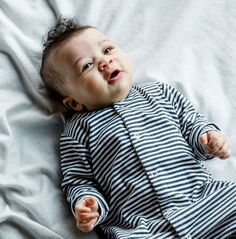 This long sleeved sleepsuit, from British designers Sleepy Doe, has a cute cool striped print. Winter Baby Clothes, Cute Baby Clothes, British Designers, Kids Winter Fashion, Gender Neutral Baby Clothes, Baby Boy Photos, Boy Onesie, Organic Baby Clothes, Baby Pants