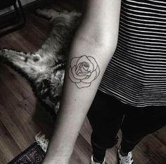 Minimalistic rose tattoo by Mateo Gonzalez