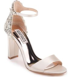 Women's Badgley Mischka Seina Ankle Strap Sandal in Ivory Satin. Sparkling crystals embellish the back of a block-heel sandal secured by a svelte ankle strap. Badgley Mischka Shoes Wedding, Wedding Shoes Heels, Bridal Shoes, Wedding Shoes Block Heel, Ankle Straps, Ankle Strap Sandals, Ivory Sandals, Color Ivory, Sparkle Shoes