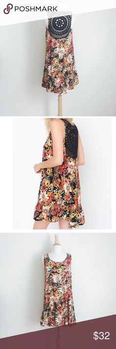 "NWT rayon floral dress w black embroidery NWT rayon floral dress! 100%rayon, soft and comfy. Black embroidery at back. Size M, chest 19"", length approx 33.5"". 🚫no trade Dresses"