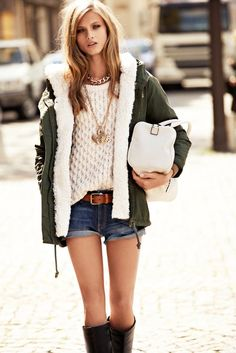 Shop this look on Lookastic:  http://lookastic.com/women/looks/necklace-pendant-duffle-bag-anorak-belt-shorts-knee-high-boots-cable-sweater/6843  — Gold Necklace  — Gold Pendant  — White Leather Duffle Bag  — Dark Green Anorak  — Brown Leather Belt  — Navy Denim Shorts  — Black Leather Knee High Boots  — Beige Cable Sweater