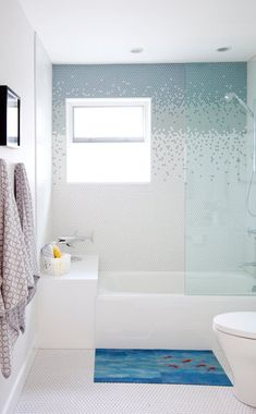 Functional ideas for decorating bathroom shower tile ideas will have you planning your bathroom remodel. Get the most from smaller spaces when tiling bathroom walls and floors Cheap Bathroom Tiles, Modern Bathroom Tile, Bathroom Tile Designs, Bathroom Floor Tiles, Simple Bathroom, Tile Floor, Bathroom Black, Basement Bathroom, Bathroom Wall