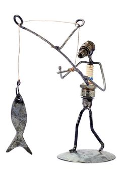 This Spark Plug Fisherman statue is made in Burkina Faso from recycled spark plugs and metal scraps.