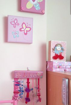 Girls bedroom decoration, my daughter Lily's room... canvases, hair clip organiser, book stands all made by mum twitter@craftyhand          www.facebook.com/craftyhandss for all designs and prices
