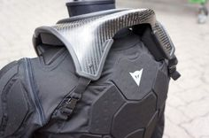 Dainese's upcoming carbon neck brace. Unlike the Leatt this one is designed to fit over most armor, which is a big bonus if it can offer the same degree of protection...