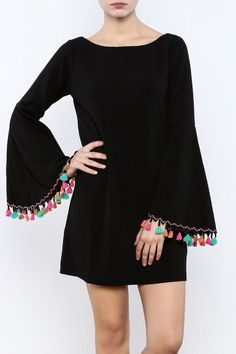 Black bell-sleeved dress with colorful tassel trim. Stylish Dresses For Girls, Stylish Dress Designs, Girls Fashion Clothes, Fashion Dresses, Classy Outfits, Trendy Outfits, Mode Grunge, Jugend Mode Outfits, Sleeves Designs For Dresses