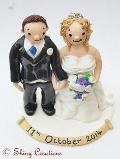 Sarah and Tom's wedding caketoppers 2014 Handmade by Shiny Creations Handmade personalised Wedding caketoppers from Shiny Creations