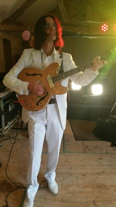 John showing off in his white suit..