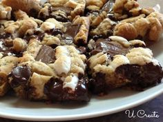 How to make smores dessert bars by U Create! Basically choc chip cookie douch with marshmallows. Mmm