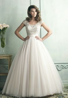 This English net ballgown features a delicate cap sleeve and gorgeously beaded bodice.
