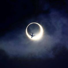 Perfect timing: Plane over an eclipse