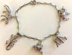 Sterling Silver Animals Charm Bracelet by beecharmerboutique $75 unique, vintage charm bracelet