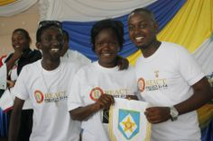 The Royals Abraham and President Mary Gladys from Rotaract Club of Mengo (UG) receive a banner from Pres. Landry of Inyenyeri during #REACT2014 Bujumbura.