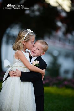 Even the flower girl and ring bearer are feeling the love at this wedding! #Disney