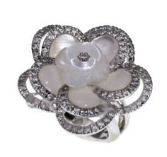 Editor's Picks from the Elizabeth Taylor Auction   Arab Women Now. A mother-of-pearl, diamond and white gold flower ring designed as a mother-of-pearl flower, set with circular-cut diamonds, mounted in 18k white gold