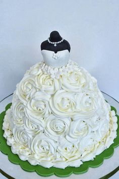 Bridal shower cake in shape of a dress. This would be quite easy: fondant on top, then buttercream roses on the bottom of the dress