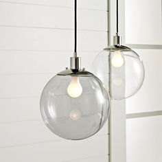 Globe pendant lights - good look for the guest bedroom. from West Elm