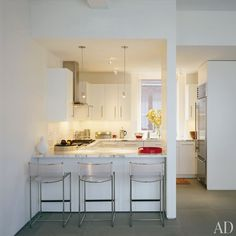 Architect Daniel Libeskind called on his friend and former student Alexander Gorlin to renovate his Tribeca loft. Gorlin removed several interior walls and swapped the kitchen and dining room. The minimalist galley now looks onto the living and dining areas.