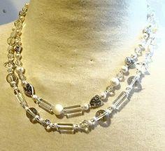 Smokey quartz, wild pearls, glass beads, crystals, silver finish pewter.  OOAK Maevyn's Lair original.