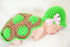 My little turtle shell photo prop, with an added bow for a baby girl.    Find With Love 'n Care Boutique on Facebook.