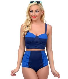 Bombshells away! A 1960s mod inspired royal blue and navy color blocked high waist bikini bottom from Kingdom & State, crafted in a supple quick dry fabrication that resists fading. Boasting a thick banded high waist, strategic paneling and fabulously full coverage. Lined in slimming power mesh and ready to set off the summer! <BR> Available in sizes XS-XL while supplies last.<BR> Top Shown Sold Separately.