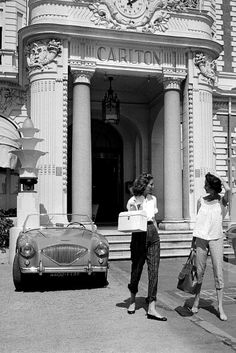 Suzy Parker and sister Dorian Leigh in front of the Carlton where they are staying while on vacation in Cannes, photo by Willy Rizzo, August...