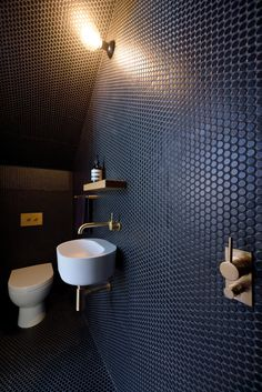 We're totally loving these quirky bathroom tiles - such a unique idea!