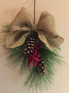 Excited to share this item from my shop: Hanging holiday decoration with pine cones red berries and a large burlap bow Christmas decoration winter wedding holiday decor Christmas Pine Cones, Rustic Christmas, Christmas Wreaths, Christmas Berries, Burlap Christmas Decorations, Christmas Quotes, Christmas Pictures, Christmas Snowman, Christmas Christmas