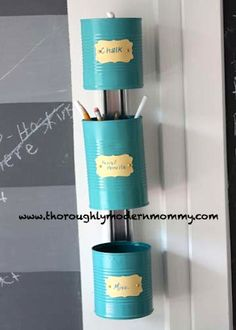 Tin cans!  Turquoise paint!  Some chalkboard stickers, and presto...a fabulous, inexpensive, eco-awesome storage system.