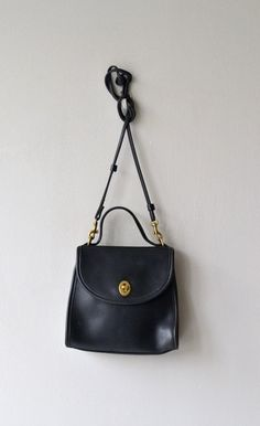 Vintage 1970s, early 1980s black leather Coach Regina bag with long, cross-body, detachable strap and short handled strap. --- M E A S U R E M E N T S