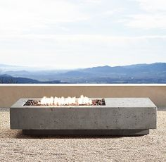 """RH Modern's 72"""" Ixtapa Propane Asymmetrical Rectangle Fire Table:Set the stage for outdoor ambience with the warmth of a clean-burning hearth. Our handcrafted fire table, made from glass fiber reinforced concrete, is finished with a multi-step process that captures the look and luxurious feel of natural limestone. Heat resistant to the touch, it uses eco-friendly clean-burning fuel."""