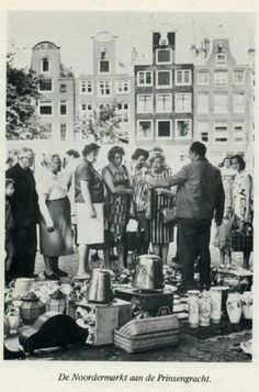 1960's. View on the Noordermarkt in the Jordaan section of Amsterdam. The Noordermarkt dates back to 1616. After completion, in 1623, of the Noorderkerk church the square came to be known as Noordermarkt. In the fifties the square also hosted a pigeon market on Saturdays. Today the square is surrounded by cafés and restaurants. A general market is held on the square every Monday. Photo Van Leer's Fotodrukindustrie N.V. #amsterdam #1960 #Noordermarkt