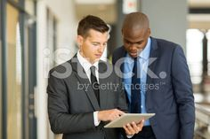 two businessmen using tablet computer royalty-free stock photo