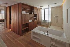 Baño abierto al dormitorio