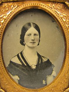 1861 ambrotype (per prior pinner of this eBay listing) of a woman with a spotted black net fichu trimmed with ribbon.