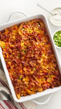 Loaded Baked Potato Casserole: An amazing cheesy potato casserole topped with ham, red bell pepper, green onions, bacon and cheese.