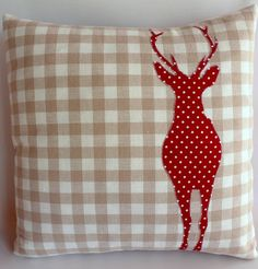 Cushion with appliqued stag that might  also make a nice, occasional block on a wall quilt.