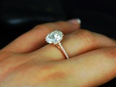 Shut the front door. This is my dream. Blake 14kt Rose Gold Oval FB Moissanite and Diamonds Cathedral Engagement Ring
